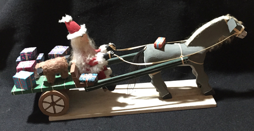 Delbert Buck creates Christmas folk art of Santa Claus